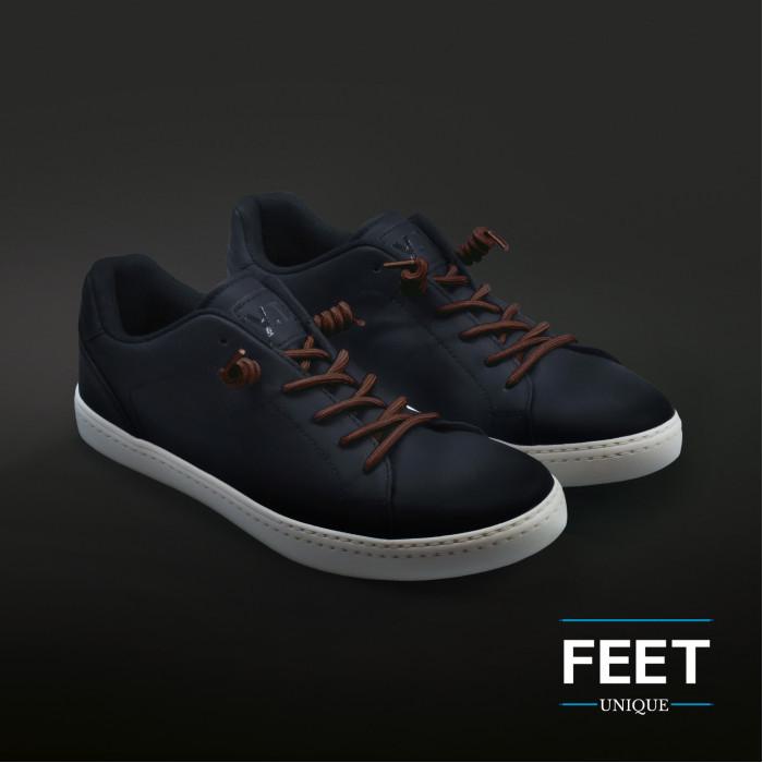Tummanruskeat kiharaiset kengännauhat