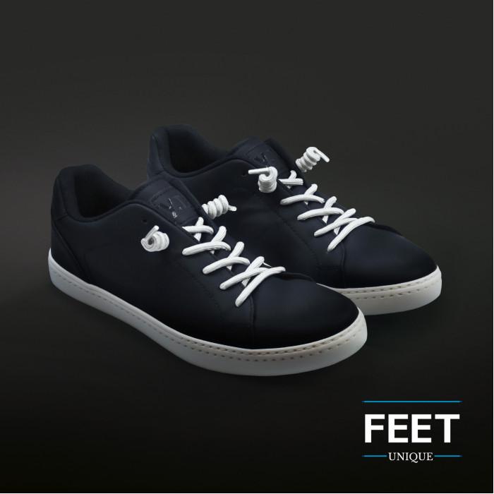 Valkoiset kiharaiset kengännauhat
